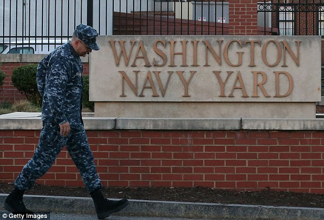 The Morning After: A member of the military arrives for work at the front gate of the Washington Naval Yard September 17, 2013 in Washington, DC