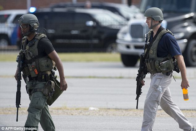 Taking off: SWAT Teams were called to the Navy Yard along with Metropolitan Police officers and engaged in a gun battle with suspect Aaron Alexis who was armed with three different guns