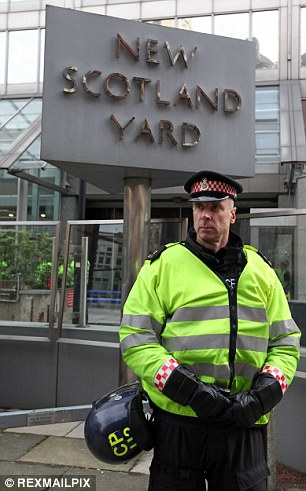 Different uniforms: Police forces paid between £14 and £43 for handcuffs, MPs said. Here a City of London police officer can be seen stood outside New Scotland Yard
