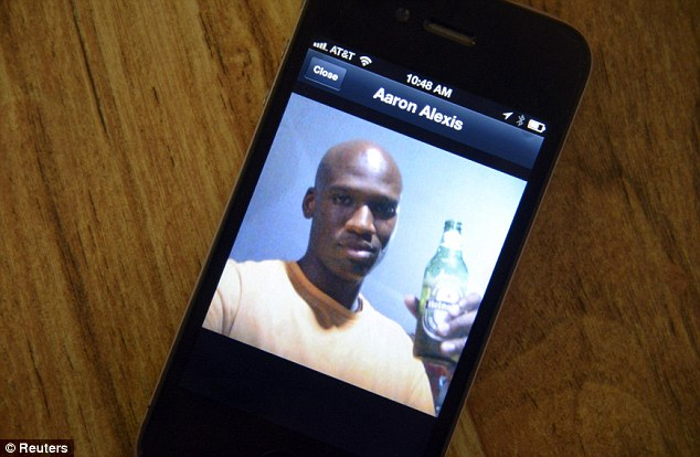 Refreshed: A photo of Aaron Alexis, 34, the suspected shooter who was among 13 people killed in the shooting at Washington Navy Yard, is displayed on the phone of Oui Suthamtewakul owner of the Happy Bowl Asian Restaurant