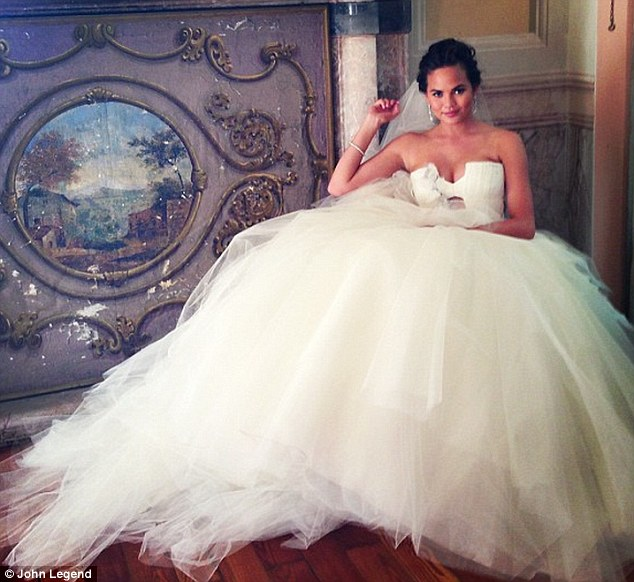 And the bride wore white: Chrissy wore this stunning frothy tulle, strapless Vera Wang gown when she tied the knot with John in Lake Como last weekend