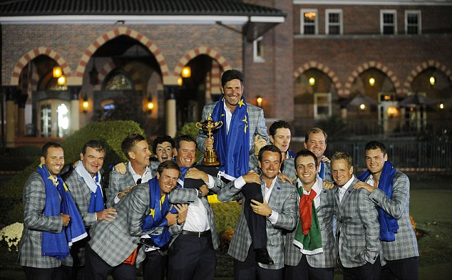What they're all playing for: Europe's team celebrate their victory in 'The Mircale at Medinah' last year