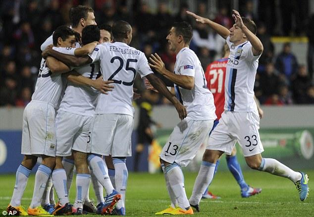 Dream start: Manchester City players celebrate their away win at Viktoria Plzen