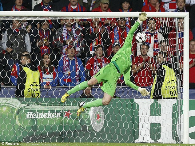 No stopping that: Viktoria Plzen's goalkeeper Matus Kozacik dives for the ball as Manchester City's Yaya Toure (unseen) scores