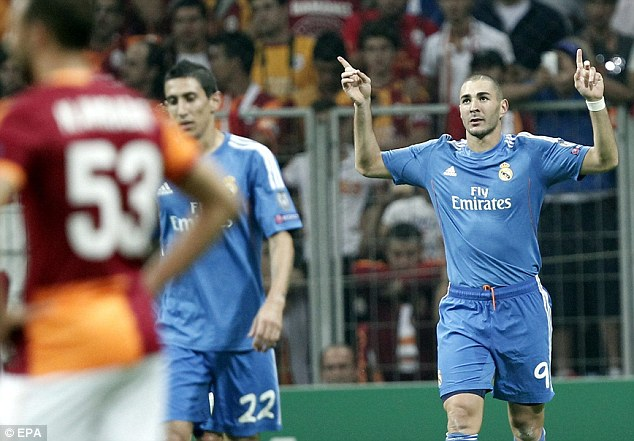 Nice work: Karim Benzema celebrates Real's second goal