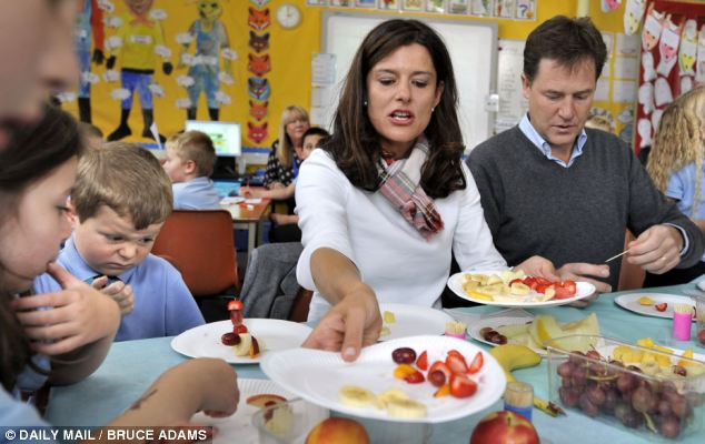 Not impressed: As the Cleggs handed out healthy fruit snacks to pupils at Lairdslands Primary School, six-year-old Dylan Hogg turned his nose up at the apple, grapes and strawberries