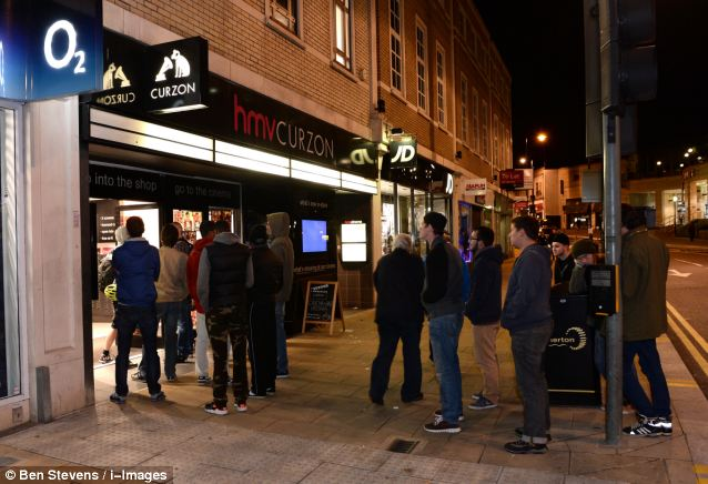 Dedicated: Fans of the game queue outside a HMV store in Wimbledon in the early hours of this morning after the launch of the game