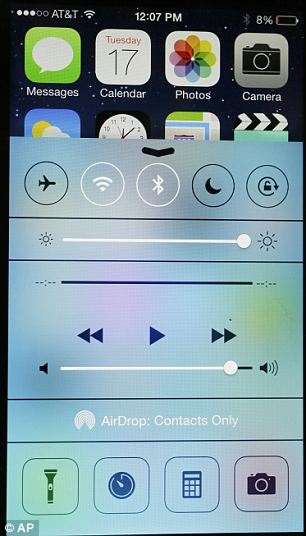 The new iOS 7 Control Centre, pictured, allows users to adjust settings and playback with just one swipe from the bottom of the screen