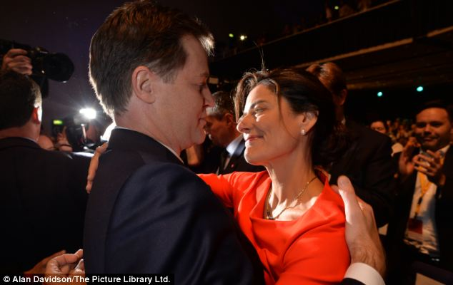 Embrace: Mr Clegg was hugged by his wife Miriam after coming off stage, to a standing ovation from party members