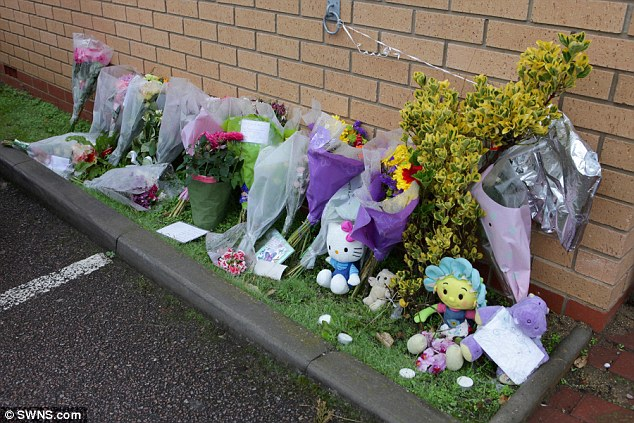 Tributes: Flowers outside the Marston Surgery in Marston Moretaine near Bedford where 23-month-old died on October 5 last year