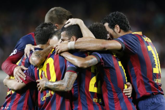 On form: Barca celebrate three points at the Camp Nou