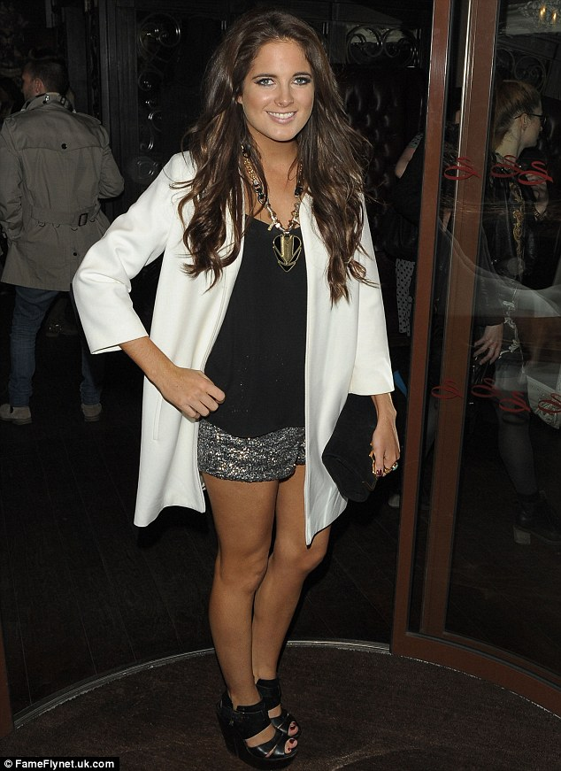 Effortlessly chic: Showing off her toned and tanned pins, Binky looked stylish in a simple black vest, gunmetal grey sequin shorts and an immaculately tailored cream jacket
