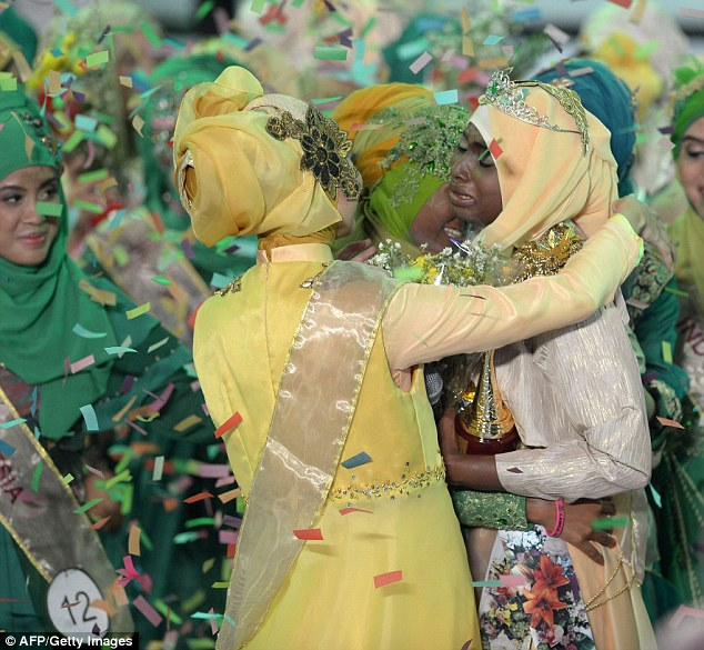 The newly crowned the Muslimah World 2013 Obabiyi Aishah Ajibola of Nigeria is congratulated by contestants during the Muslimah World competition in Jakarta yesterday