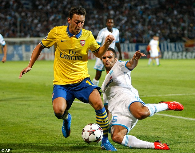 Harsh: Mesut Ozil was awarded a four for his performance against Marseille