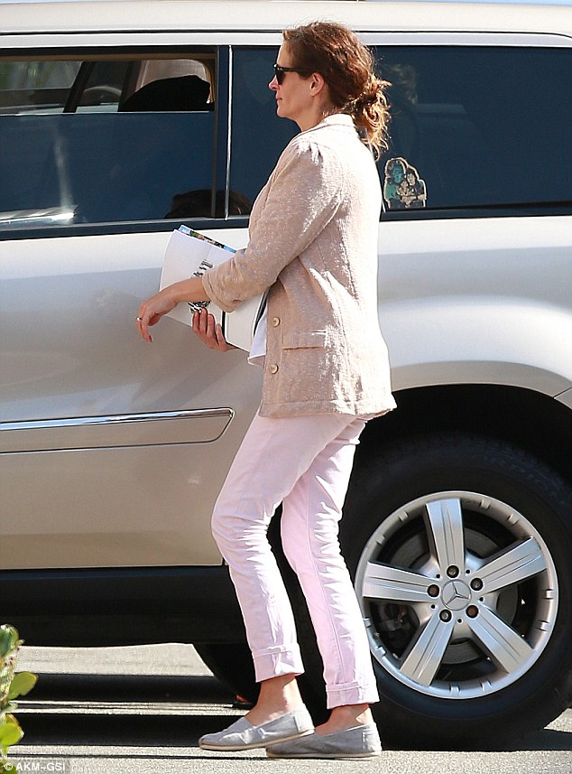 Low-key: The actress pulled her auburn locks into a messy bun and appeared to be wearing no make-up as she walked to their car