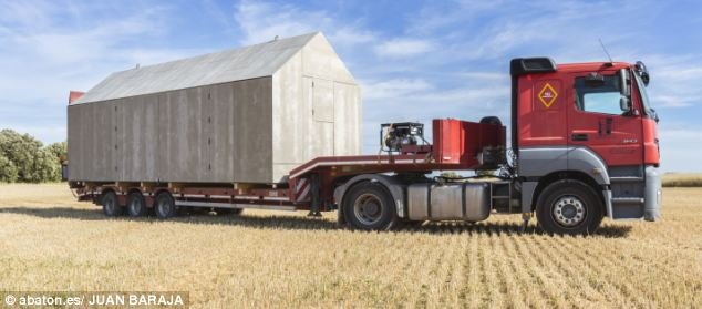 Moving house: The portable home fits comfortably on the back of a lorry