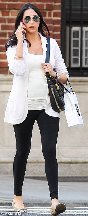 Rocking the maternity monochrome: The 36-year-old socialite looked utterly immaculate, teaming a white knitted cardigan with black skinny jeans and pumps as she showed off her baby bump in a tight vest