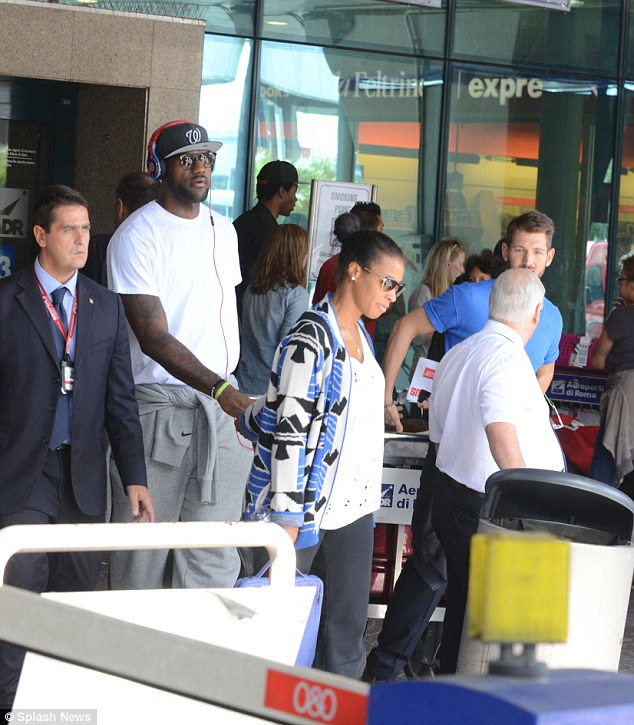 Savannah leading the way: The day before on Tuesday the couple were spotted arriving at the airport