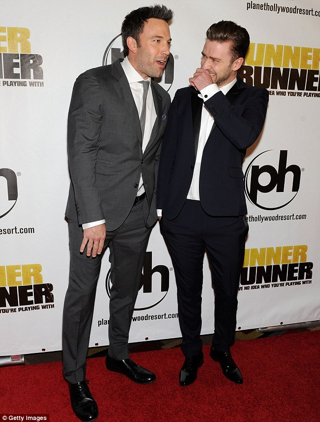 Sharing a joke: Stars of the film Ben Affleck and Justin Timberlake looked equally dapper in their suits