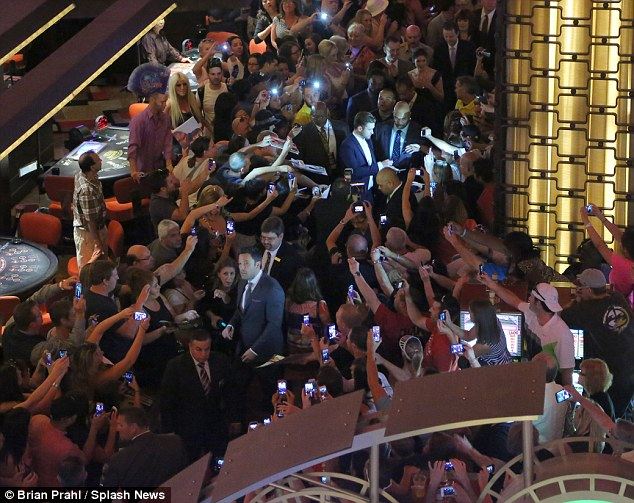 Make way! Crowds of fans mobbed Affleck and Timberlake as they arrived at Planet Hollywood Casino & Resort