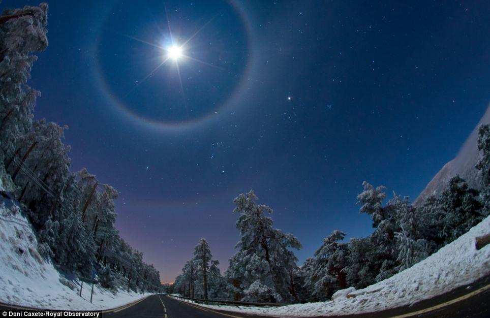 Surreal: Spaniard Dani Caxete's image shows a quadruple lunar halo illuminating the landscape below