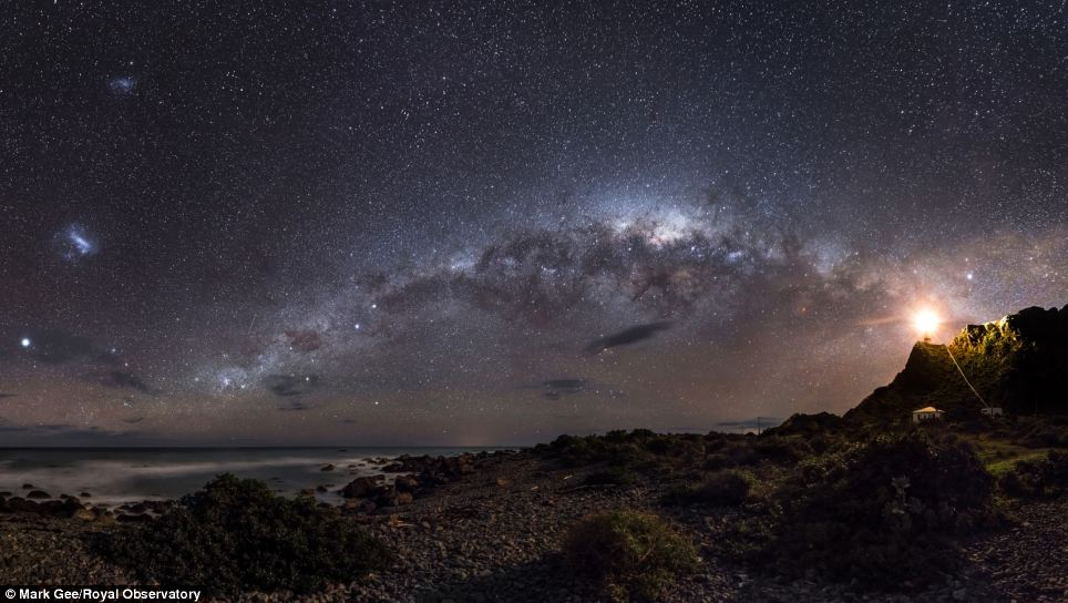 Mark Gee's image of the Milky Way came first in the Earth and Space Category in the Astronomy Photographer of the Year awards. The shot shows central regions of the Milky Way Galaxy - over 26,000 light years away - appearing as a tangle of dust and stars, lit up by a lighthouse on the Cape Palliser, New Zealand, shining out to sea