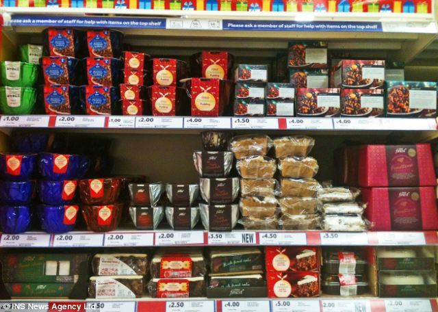 Early bird: Tesco has also faced criticism on Twitter for stocking Christmas goods already. Mince pies and Christmas puddings are pictured at the store in Camberley, Surrey