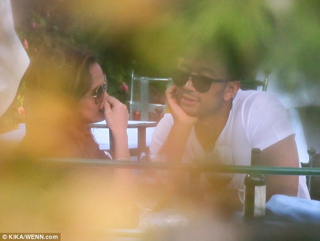 The look of love: The couple seemed oblivious to onlookers as they were deep in conversation on their romantic honeymoon