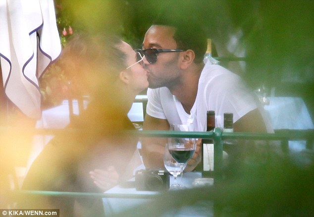 Lip service: The blissed-out newlyweds shared a passionate embrace over dinner in a restaurant in Portofino, Italy on September 18