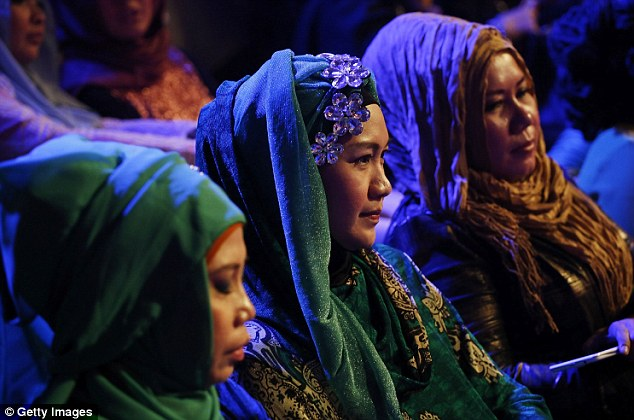 Muslim women in the audience of the pageant