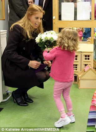 Princess Beatrice speaks to Rebecca Cullen, six, and receives a bunch of flowers