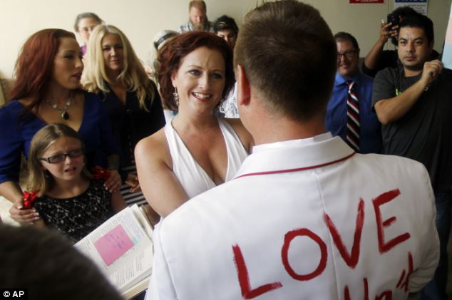 Look of love: Araguz smiles as William Loyd recites his vows during their wedding in front of the courthouse