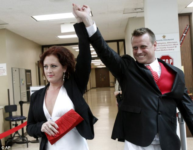 Celebration: Araguz and Loyd emerge from the court room. They had struggled to get a marriage license as Texas still recognizes her as a man even though she has documents showing her transition