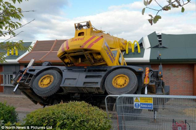 Crash: A crane smashed into the roof of a McDonald's restaurant in Consett, County Durham, at about 1pm today