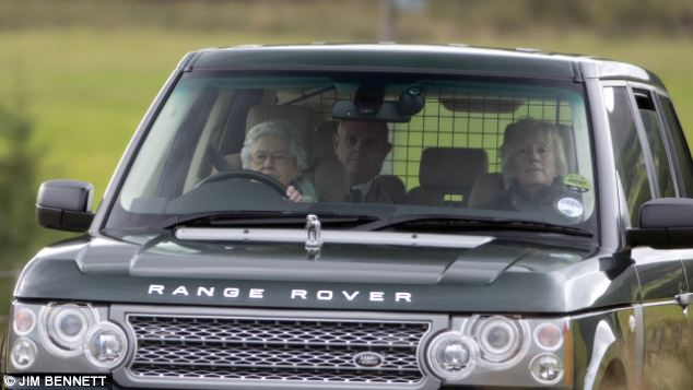 In charge: The Queen looks relaxed as she ferries a car full back to the estate following the shoot
