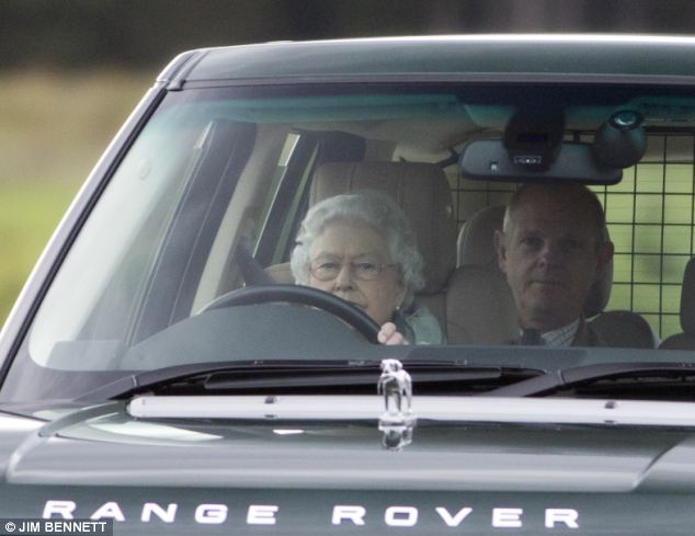 Behind the wheel: The Queen is pictured driving a Range Rover away from a grouse shoot at Balmoral