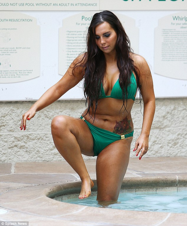 She rises: Leathers carefully climbs out of the pool, deciding she has had enough for the day