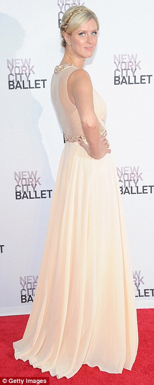 Classic: Nicky Hilton looked positively angelic in her Grecian gown, which featured beading and a sheer back panel, while she continued the theme with her braided up-do