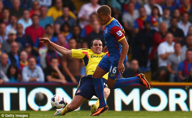 Back: John O'Shea sat out last weekend's 3-1 home defeat by Arsenal after being sent-off at Crystal Palace