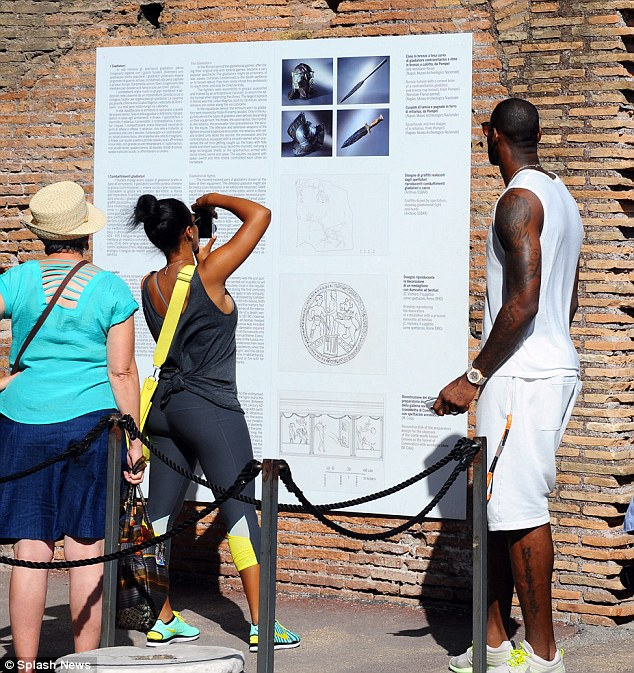 Taking it all in: They read up on the history and even took pictures of the signs to remember the sights they've seen
