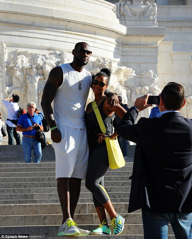 One for the family album: They both wore matching sporty outfits as they wandered through the Altare della Patria