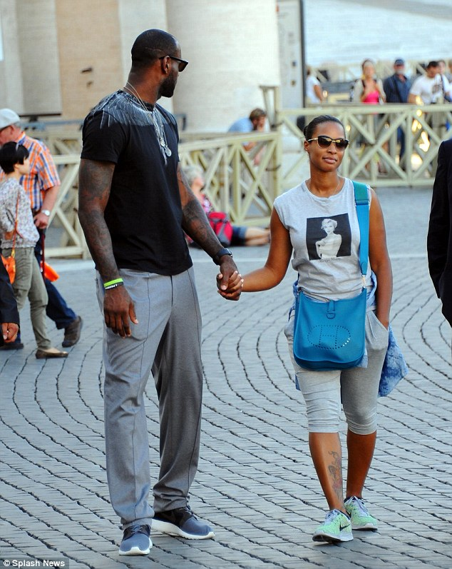 Relaxed: The 6ft 8in basketball player stood out thanks to his statuesque physique