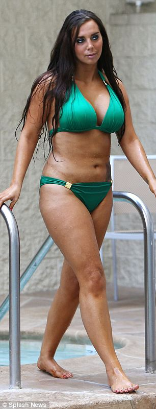 Curvy: Sydney returns to her sunbed to continue topping up her tan
