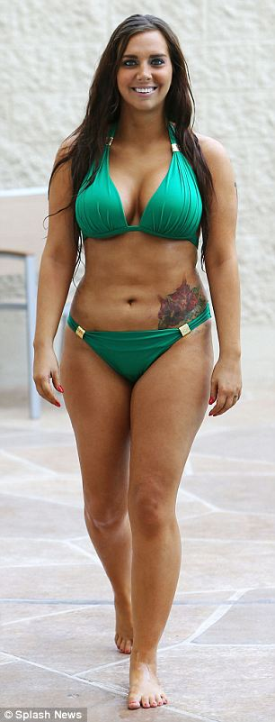Smiling: Leathers, whose revelations derailed Weiner's hopes of being elected Mayor of New York City, was busy checking and sending messages on her phone while topping up her tan in a green bikini