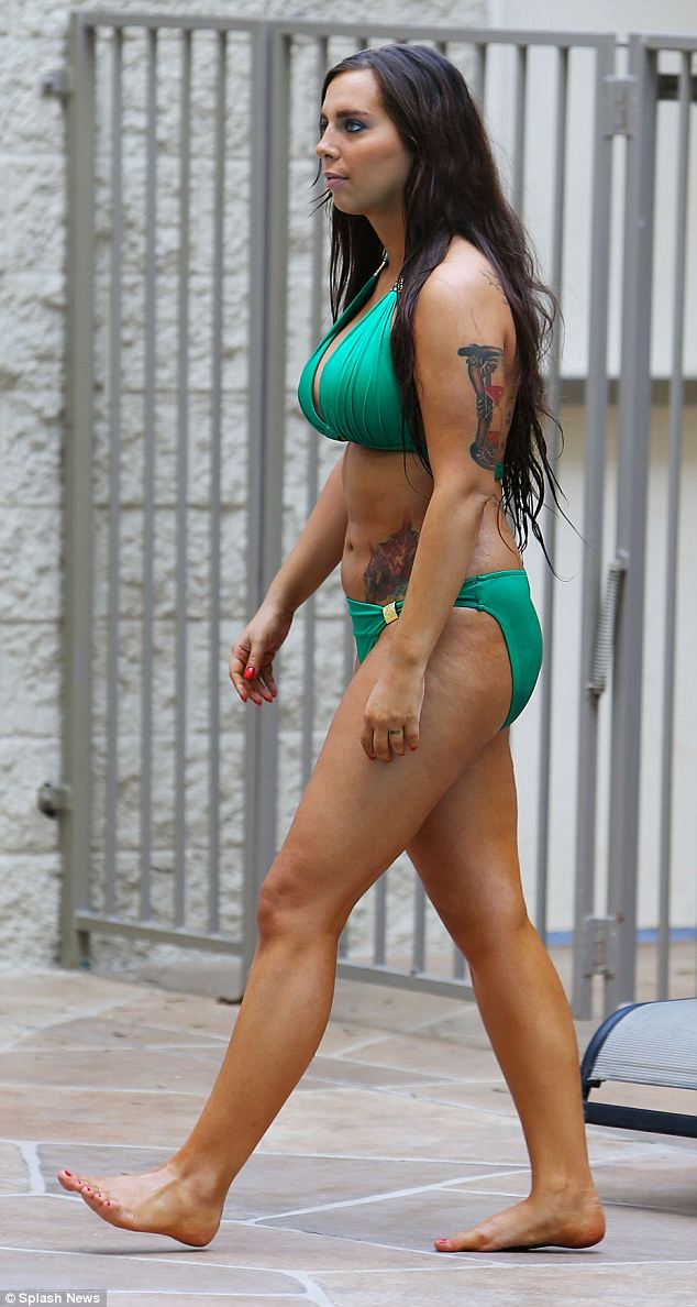 Nonchalant: Sydney had a number of plastic surgery procedures performed before the mayoral primaries, including a breast enlargement, liposuction on her stomach and a nose job. She also had her teeth done