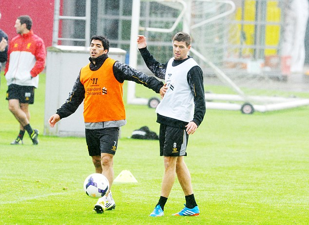 Influential figure: Rodgers is happy to have Luis Suarez back in his side soon