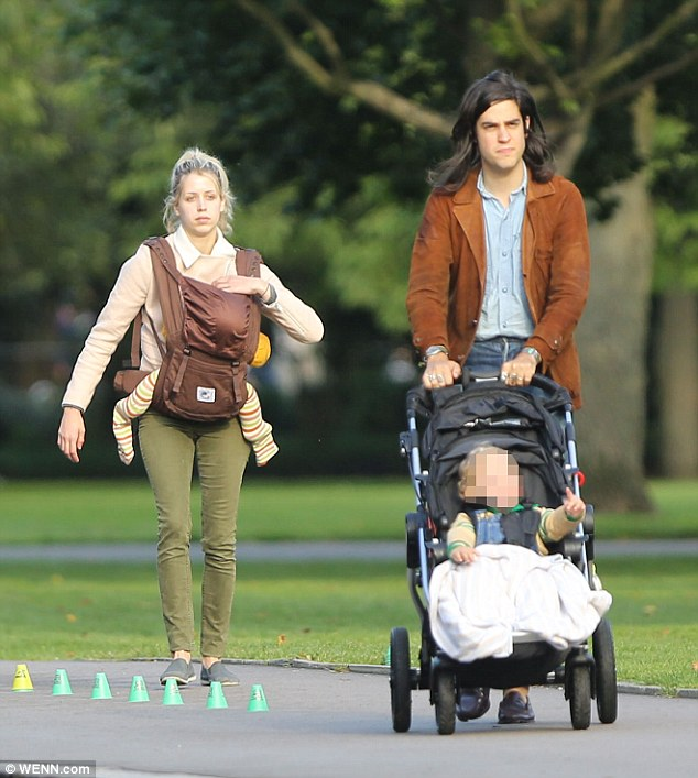 Quality family time: Peaches Geldof and husband Tom Cohen make the most of a warm and sunny day taking sons Astala and Phaedra to a local park