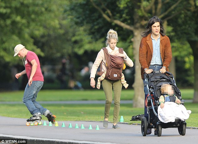 Excess baggage: Peaches lightens her husband's load by carrying her youngest son in a custom sling