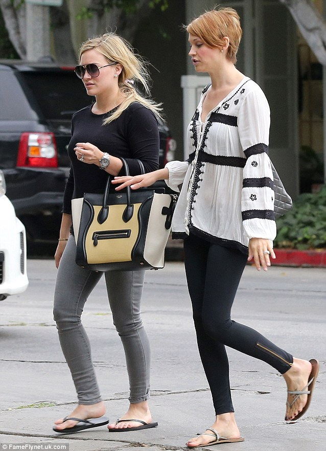 Girly day: Hilary Duff and Lisa Stelly head to a beauty salon for a manicure