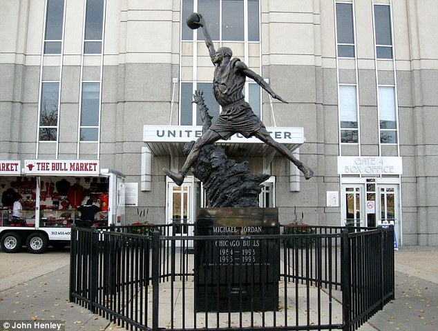 Reaching out: One man asked for a picture of the Michael Jordan statue in front of the United Center basketball stadium in Chicago